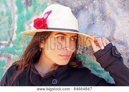 Beautiful woman against a graffiti background