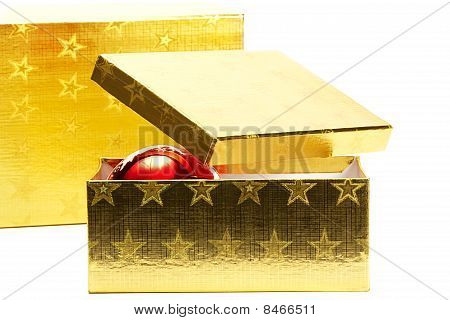 two golden present boxes with one christmas ball