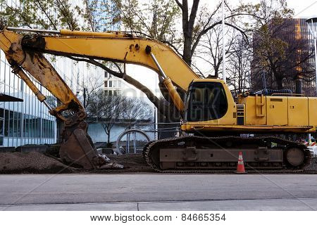 Large Heavy Construction Equipment Idle Downtown Site