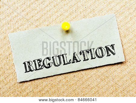 Recycled Paper Note Pinned On Cork Board. Regulation Message. Concept Image