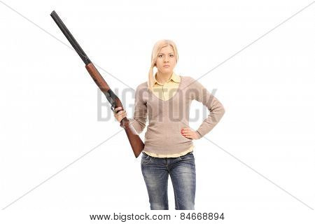 Dangerous girl holding a shotgun isolated on white background