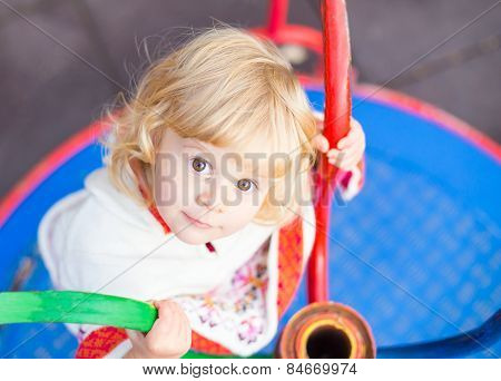 Cute Little Girl In The Playground