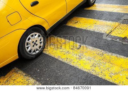 Yellow Taxi Car Stands On Pedestrian Crossing