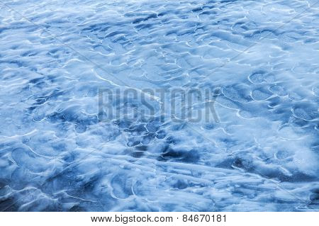 Blue Melting Ice Surface On The Frozen Water