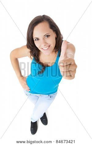 Attractive teenage girl showing thumbs up