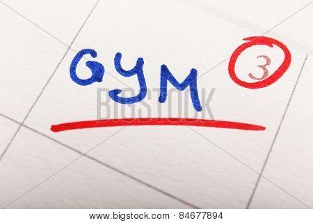 Written plan Gym on calendar page background