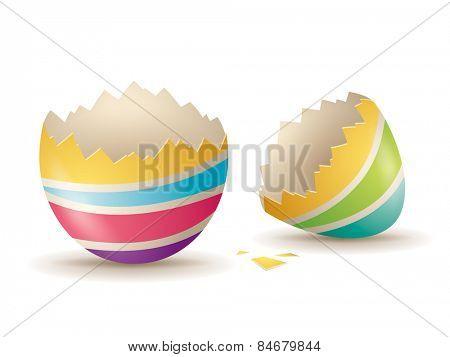 Cracked eggshell. An empty egg shell halves over white background.