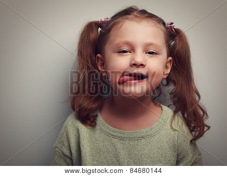 Grimacing Beautiful Little Girl Showing The Tounger. Closeup Vintage Portrait