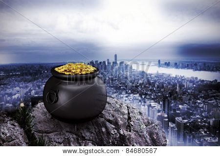 pot of gold against large rock overlooking huge city