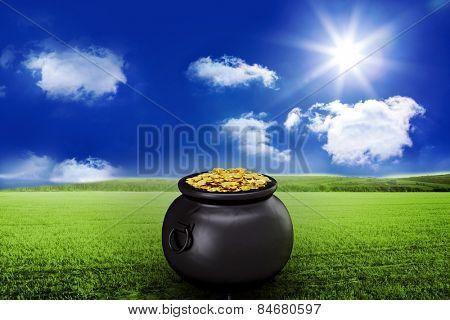 pot of gold against sunny green landscape