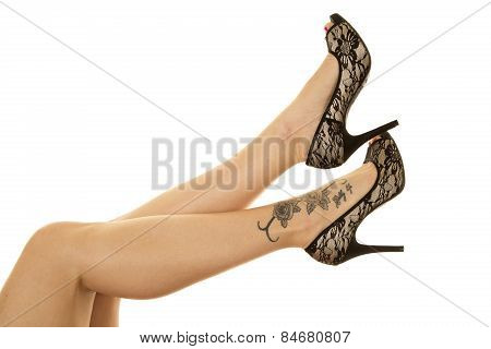 Woman Legs Tattoo On Foot Black Heels Out