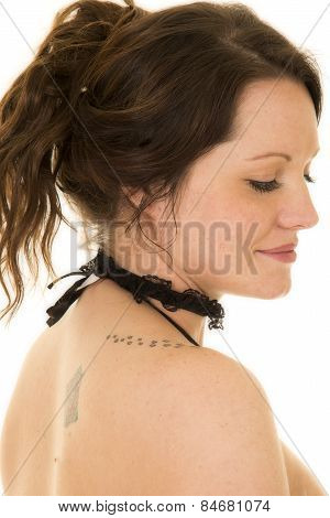 Woman With Hair Up From Side Eyes Down Bare Shoulder Close