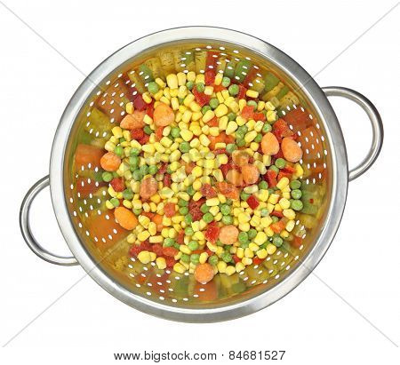 Colander with frozen mixed vegetables isolated on white
