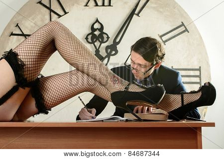 Sexy Long Legs Is On The Desk In Front Of Man