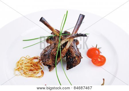 eye ribs on white plate with pepper and tomatoes