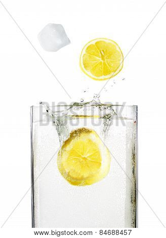 Ice Cube With Lemon Drops From Splashes Into The Glass With Alcohol