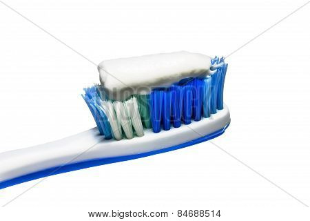 Toothpaste on the toothbrush isolated on white background