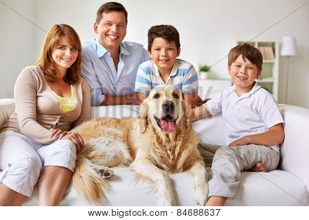 Happy couple, their two sons and dog