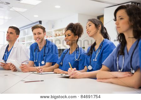 Medical student smiling at the camera during class at the university