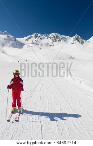 Happy Girl Skier On A Ski Slope
