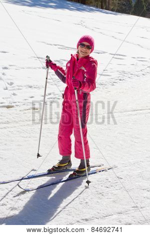 Portrait Of Cute Little Girl Cross-country Skiing