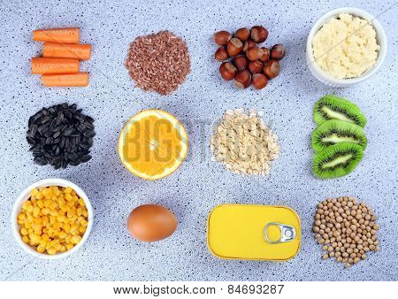 Various food products containing vitamins on table
