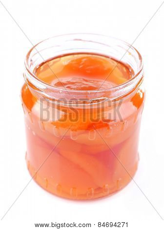 Homemade jar of apricot jam isolated on white background