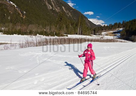 Girl Skier Sitting On A Ski Slope