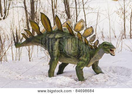 plastic figure of a dinosaur in dinopark
