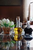 pic of vinegar  - Bottles of olive oil and vinegar on a table in a cafe - JPG