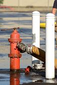 foto of firefighter  - Firefighters at the fire hydrant while using large volume appliance water delivery master streams - JPG