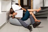 image of office romance  - Young couple flirting in office - JPG