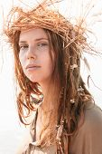 picture of dreads  - Close up Young Woman in Boho Style with Dreads Wearing Crown of Hay While Looking at the Camera - JPG
