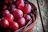 image of wooden basket  - organic ripe grapes  - JPG