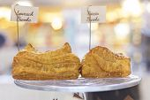 picture of baked potato  - Fresh baked spinach and potato burekas on display stand - JPG