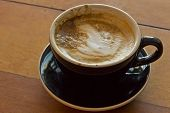 foto of latte  - Hot morning Italian latte with cream in rustic atmosphere - JPG