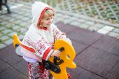 picture of playground  - Beautiful little girl laughing and playing in the playground - JPG