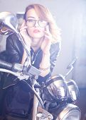 pic of chopper  - Portrait of an attractive woman with glasses on chopper - JPG