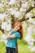 stock photo of teeth  - Happy Woman with Gorgeous Red Hair Enjoying Nature - JPG