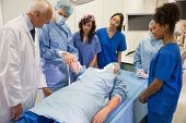stock photo of professor  - Medical students learning from professor at the university - JPG