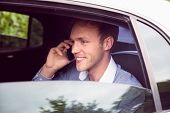 foto of limousine  - Young man talking on phone in limousine on a sunny day - JPG