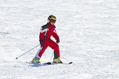 foto of ski boots  - Little girl skiing downhil on a sunny day - JPG