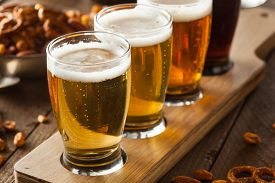 stock photo of cold drink  - Assorted Beers in a Flight Ready for Tasting - JPG