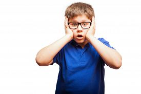 picture of shock awe  - Young blond boy looking shocked and surprised in a white background - JPG
