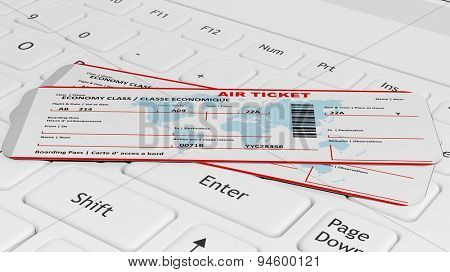 Two air tickets on white laptop keyboard