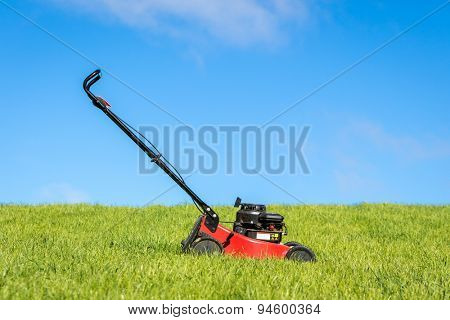 Lawn mower in green grass