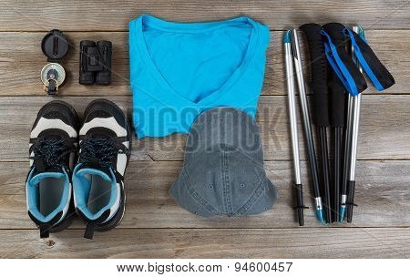Blue Color Coordinated Outdoor Walking Accessories On Rustic Wooden Boards
