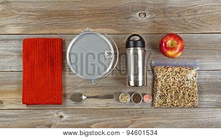 Cooking Gear For Hiking Or Camping On Rustic Wooden Boards