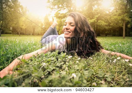 Woman lying in a field