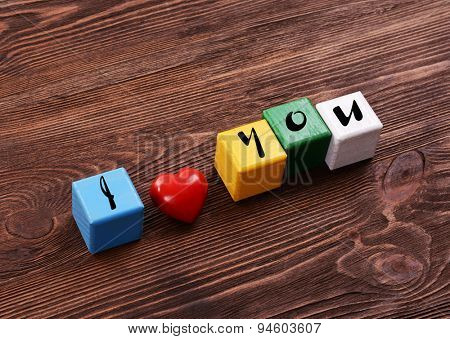 Colorful cubes for inscriptions on wooden background